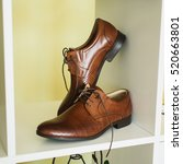 brown man's shoes stand on a...   Shutterstock . vector #520663801