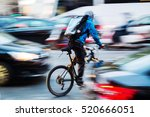 bicycle messenger in busy city... | Shutterstock . vector #520666051