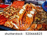 various seafood on the shelves... | Shutterstock . vector #520666825
