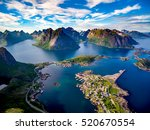 Lofoten islands is an archipelago in the county of Nordland, Norway. Is known for a distinctive scenery with dramatic mountains and peaks, open sea and sheltered bays, beaches and untouched lands. - stock photo
