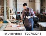 portrait of a carpenter... | Shutterstock . vector #520703245