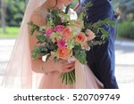 bride holding a beautiful... | Shutterstock . vector #520709749