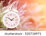 white alarm clock on wooden... | Shutterstock . vector #520718971