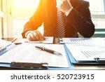 businessman analyzing financial ...   Shutterstock . vector #520723915