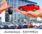dealer hand with a car key. | Shutterstock . vector #520749814