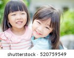Two Little Girls Smile Happily...