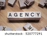 Small photo of Agency Word Written In Wooden Cube