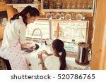 daughter helping her mother in... | Shutterstock . vector #520786765