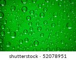 water drops in green light - stock photo
