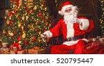 Santa Claus Eating Cookies And...