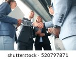 Stock photo business people shaking hands finishing up a meeting 520797871