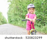Happy Child Riding A Bike In...