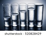 a row of glasses for vodka.... | Shutterstock . vector #520828429