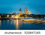 Small photo of Great St. Martin Church And Dom In Cologne At Evening With Reflection In River Rhine In Cologne, Germany