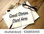 """Small photo of Motivation Concept: Word """"Great Stories Start Here"""" on notebook"""