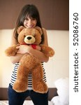 Young Woman With Teddy Bear In...