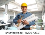 man holding plans and tools... | Shutterstock . vector #52087213
