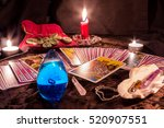 tarot cards by candlelight in... | Shutterstock . vector #520907551