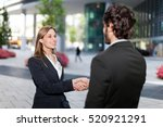 handshake between business... | Shutterstock . vector #520921291