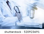 doctor with microscope  medical ... | Shutterstock . vector #520923691