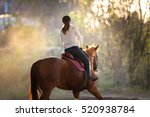 Stock photo young pretty girl riding a horse 520938784