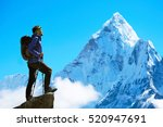 hiker with backpacks reaches... | Shutterstock . vector #520947691