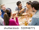group of young people eating... | Shutterstock . vector #520948771