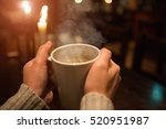 woman's hands with a cup of... | Shutterstock . vector #520951987