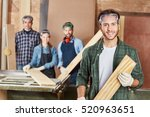 man as carpenter with wood on... | Shutterstock . vector #520963651