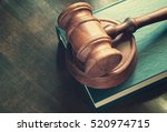 gavel and legal book on wooden... | Shutterstock . vector #520974715
