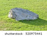 a solid rock in the middle of... | Shutterstock . vector #520975441