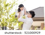 father carrying daughter up... | Shutterstock . vector #521000929