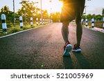 handsome man running on road... | Shutterstock . vector #521005969