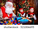 santa claus and the elves make... | Shutterstock . vector #521006695