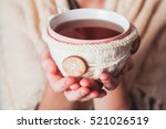 woman with cup of tea | Shutterstock . vector #521026519