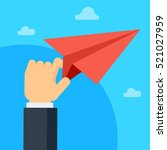 paper plane in hand of the... | Shutterstock .eps vector #521027959
