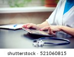 Woman Doctor Using Tablet...