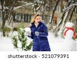 Young Woman Plays Snowballs. I...