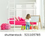 child draws in the children's... | Shutterstock . vector #521105785