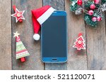 smart phone with christmas hat    Shutterstock . vector #521120071