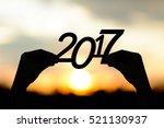 silhouette  2017  in hand....   Shutterstock . vector #521130937