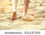 woman walking on sand beach... | Shutterstock . vector #521137291