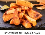 sweet potato pieces on slate... | Shutterstock . vector #521157121