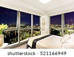 comfortable bed near city view... | Shutterstock . vector #521166949