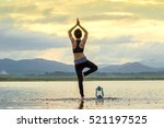 asian young woman doing yoga in ... | Shutterstock . vector #521197525