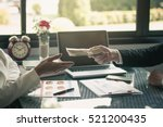 man offering batch of hundred... | Shutterstock . vector #521200435