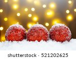 red christmas balls in the snow | Shutterstock . vector #521202625