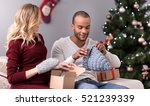 cheerful happy man trying on a... | Shutterstock . vector #521239339