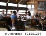 couples enjoying lunch in a... | Shutterstock . vector #521261299