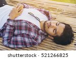 young man sleep on bamboo bed.   Shutterstock . vector #521266825